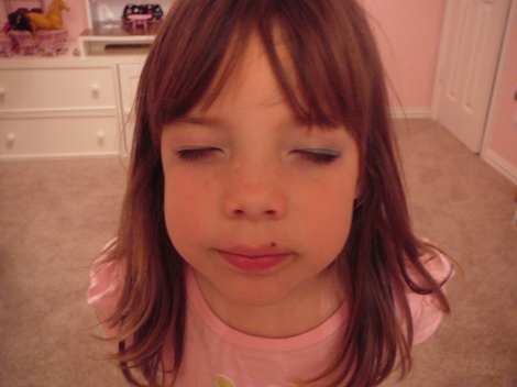 She was especially proud of the eye makeup!